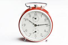 old red analog alarm clock. - stock photo