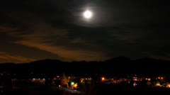 Time Lapse of moon setting over community -  4K - 4096x2304 Stock Footage