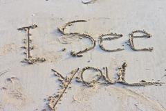 Stock Photo of the inscription on the sand
