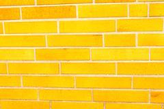 fake yellow brick wall siding - stock photo