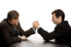 Two business men wrestling isolated on white background Stock Photos