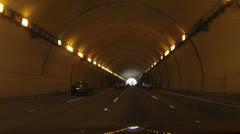 Driving through dark tunnel in car POV HD 021 - stock footage