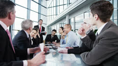 Diverse team of business people in a meeting - stock footage