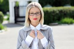 Beautiful young woman in sunglasses. outdoor portrait Stock Photos