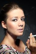 portrait of a girl in tobacco smoke - stock photo