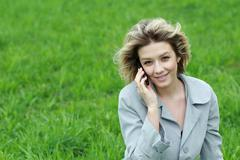 portrait of young woman talking on mobile phone - stock photo