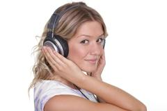 Happy young woman listening to music Stock Photos
