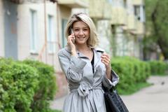 Portrait of young woman talking on mobile phone Stock Photos