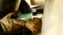 A worker grinding steel container Stock Footage