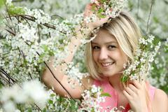 Stock Photo of portrait of beautiful blond in spring blossom
