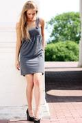 Attractive young woman in a sexual dress Stock Photos