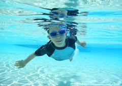 boy swimming, underwater shot - stock photo