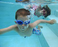 swimming underwater - stock photo