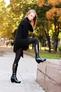 beautiful woman walking in park - stock photo