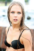 young sexy woman bathes in a city fountain - stock photo
