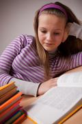 the student does lessons - stock photo
