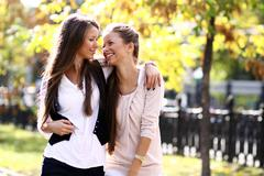 Two cheerful girls twins, in the street Stock Photos