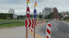 Direction road signs end roundabout road construction cars go Stock Footage