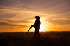Woman Bird Hunter in Sunset Stock Photos