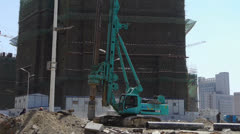 Heavy drill machinery moving in construction site. Stock Footage