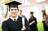 Graduation: cheerful graduate with diploma Stock Photos
