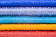 gleaming silk in five bright colours - stock photo
