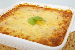 Cheese topped casserole straight from the oven Stock Photos