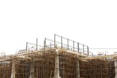 Unfinished building construction site isolated on white background Stock Photos