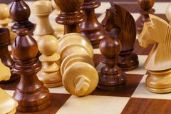 chess game in progress fallen king - stock photo