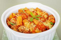 Pasta bake with italian sausage meatballs casserole rigatone Stock Photos