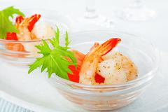 Prawns shrimp smoked salmon mizuna appetiser Stock Photos