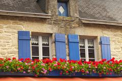 Windows with shutters and window boxes concarneau brittany france Stock Photos
