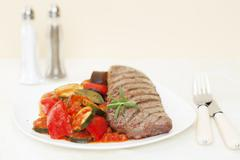 grilled lamb backstrap with ratatouille - stock photo