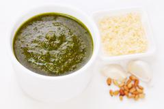 Green pesto with pine nuts garlic parmesan cheese Stock Photos