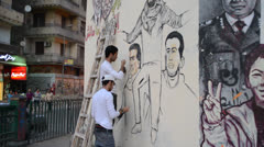 activist drawing Graffiti in tahrir square for Detainees - stock footage