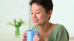 Happy Chinese woman drinking tea Stock Footage