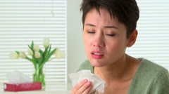 Woman sick with flu sneezing Stock Footage
