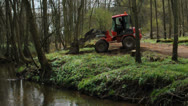 Man driving an Exavator in the forest Stock Footage