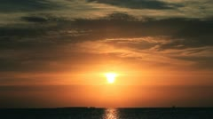 Sun rise in the sea with orange sky time lapsw Stock Footage