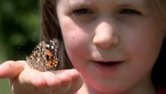 Child with butterfly Stock Footage