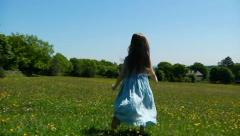 Child dancing in meadow - stock footage