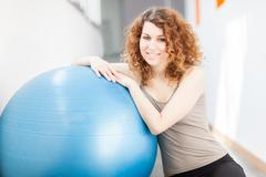 Young woman doing exercise with a gym ball Stock Photos