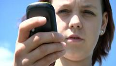 Teen girl texting Stock Footage
