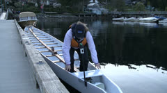 Climbing Out Of Competition Long Canoe Stock Footage