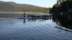 Female Paddlers In Long Canoe On Practice Run - stock footage