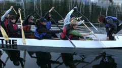 Paddlers In Long Canoe Beginning Practice Run Stock Footage