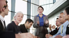 Diverse, happy business team in a meeting in contemporary office building Stock Footage
