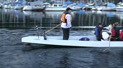 Paddlers In Long Canoe Setting Off From Dock Stock Footage
