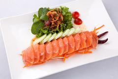 Sashimi salmon with spicy salad Stock Photos