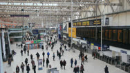 Travelers at Saint Pancras Station in London Stock Footage